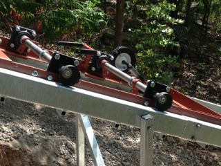 Hill Hiker Incline Elevator chassis in captured rails with knurl safety brakes engaged