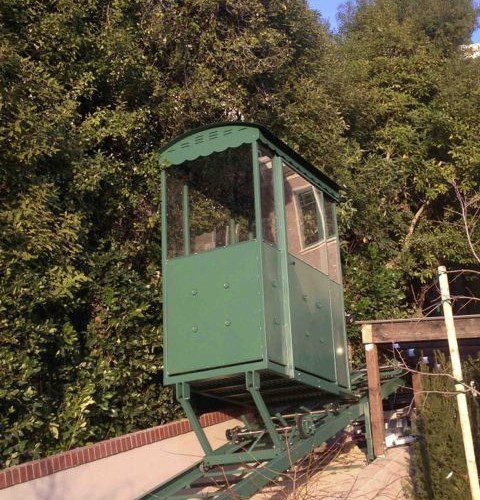 Custom designed fully enclosed hill tram car with sheet metal roof in California