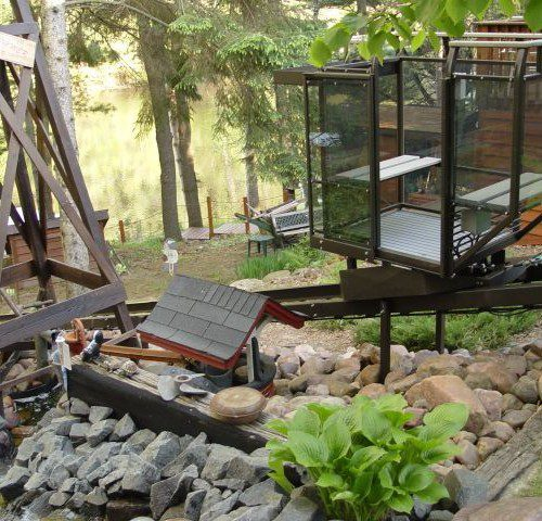 Up north cabin tram lift with fun landscaping and waterfront lake entry