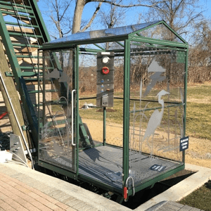 Hill Hiker fully enclosed polycarbonate wall and roof commercial ADA handicap incline elevator car