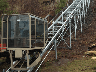 Hill Hiker outdoor tram system with helical screw piles support structure