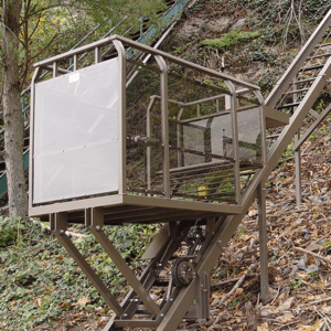 Hill Hiker inclined elevator with standard steel construction, powder coat painted track rail and powder coat painted car finish