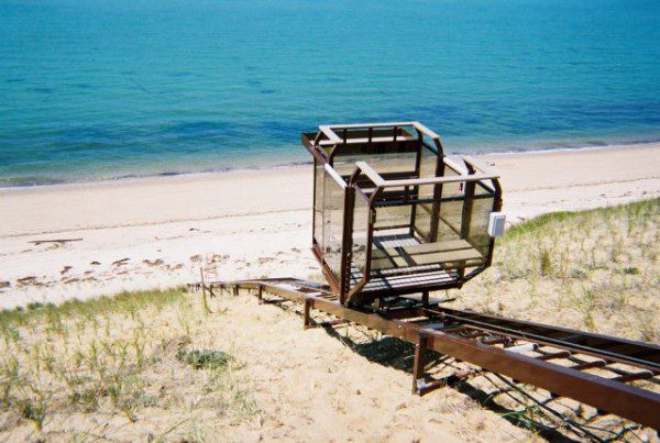 Beautiful sand beach with blue ocean water with access provided by beach incline elevator lift