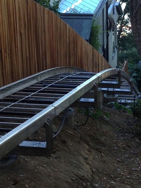 Hill Hiker curved stainless steel track rail on concrete column piers